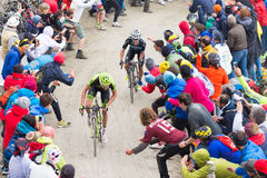 Tour of Italy: Cyclist racing on mountain dirt road Royalty Free Stock Images