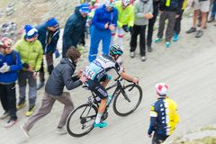 Tour of Italy: supporter pushing cyclist on mountain road Royalty Free Stock Photography