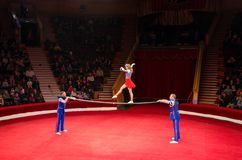Tour of Moscow State Circus named after Nikulin. Acrobats on poles royalty free stock photo