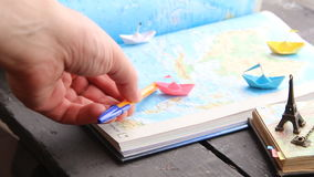 Tour Packages or Travel agent idea. Paper boats on the map and the Eiffel Tower. Travel to World. Tourism. Paper boats on the map stock video footage