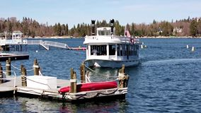 Tour Paddle Boat Pulling into dock. Tour boat Lake Arrowhead Queen pulling into dock. Tour of celebrity mountain lake side resort estates from paddle boat tours stock video footage