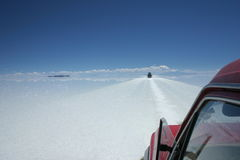 Tour through the salt flats of Bolivia by suv Royalty Free Stock Images