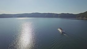 Tour Ship Lake Aerial 4k. Aerial of a trip boat in Bieszczady, Poland. 4k footage stock video