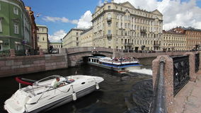 Tour ships turn to the Winter canal. St. Petersburg, Russia stock footage