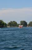 Tour Side Wheeler. Side-wheeler tours around the lake with tourists Royalty Free Stock Photos