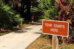 Tour Starts Here Sign Royalty Free Stock Photography