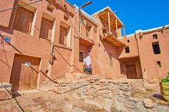 Tour to Abyaneh, Iran. The typical street of Abyaneh village with preserved red adobe houses, located on the slope of Karkas mount, Iran stock photo