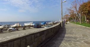 Tour of the tourist promenade in the old Pomorie, Bulgaria stock footage