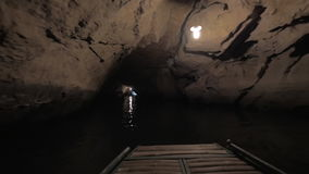 Tour for tourists in Vietnam, the boat trip through the dark cave system stock video footage
