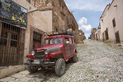 Tour vehicle on cobblestone street in Real de Catorce Mexico. May 22, 2014 Real de Catorce, Mexico: vintage all-terrain vehicles are used for tourist tours Stock Photography