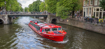 Tourboat with tourists during a sightseeing tour of the canals o Royalty Free Stock Photo