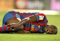 Toure Yaya injured. Toure Yaya of Barcelona injured during a Spanish League match between FC Barcelona and Athletic Bilbao at the Nou Camp Stadium on April 3 Royalty Free Stock Photo
