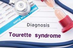 Tourette综合症状诊断  在精神病医生或心理学家桌是纸以题字Tourette综合症状疾病在p附近 图库摄影