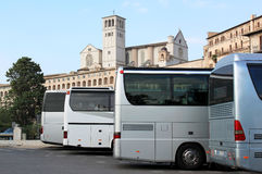 Tourincars in pilgrimage town Assisi, Italy Royalty Free Stock Images