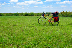 Touring bicycle. Loaded touring bicycle on rest break in field stock photos