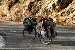 Touring bicycle loaded with panniers. On mountains road stock image