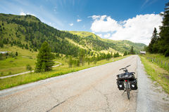 Touring bike on alpine road Royalty Free Stock Image