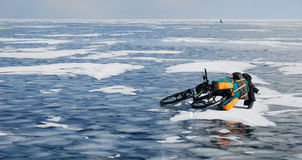 Touring bike on the frozen lake Royalty Free Stock Photos