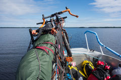 Touring bikes tied securely to a fishing boat on lake Saimaa, Finland Royalty Free Stock Images