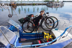 Touring bikes tied securely to a fishing boat on lake Saimaa, Finland stock photos