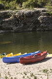 Touring canoes on river bank Royalty Free Stock Images