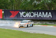 Touring car race in Pattaya, Thailand, June 2012. PATTAYA - JUNE 17: Honda Civic with driver Pattarapon catching fire during a touring car race at Bira Circuit Stock Photography