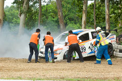 Touring car race in Pattaya, Thailand, June 2012. PATTAYA - JUNE 17: Rescue team extinguishing the fire in a Honda Civic with driver Pattarapon during a touring Stock Photography