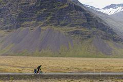 Touring cyclist are bicycling in Iceland at summer season stock photos