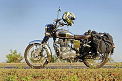 Touring Motor cycle parked on Roadside Royalty Free Stock Images