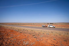 Touring Outback Australia - Four Wheel Drive Towing Camper Trail Royalty Free Stock Photo