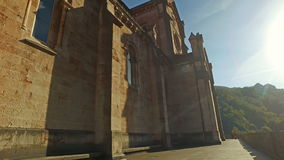 Touring the perimeter of the Basilica of Covadonga 05 stock footage