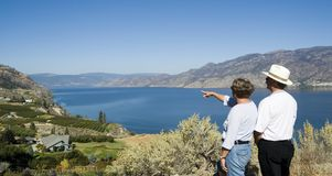 Tourism. Two tourists pointing at scenic viewpoint Royalty Free Stock Images