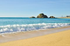 Tourism attraction, Blanes beach near Costa Brava, Spain. Beautiful sunny day on the exotic beach of Blanes in Catalonia, close to Costa Brava, Spain Royalty Free Stock Photo