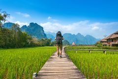 Tourism with backpack walking on wooden path, Vang vieng in Laos.  Stock Image
