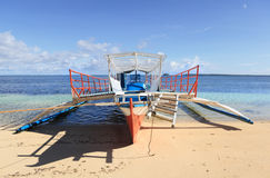 Tourism bangka boat Philippines. A typical local bangka outrigger vessel or boat as used for passenger and tourism transport in the Philippines: view on the Royalty Free Stock Photos