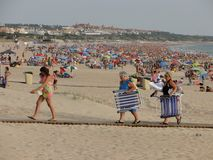 Tourism on the beaches. Of Andalusia, south of Spain. Photo taken on the beach of La Barrosa in summer season when people are on vacation at the beach Royalty Free Stock Image