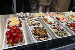 Tourism Belgium Food. A tasty selection of Belgian waffles with various fruit, cream and chocolate sauces Royalty Free Stock Images