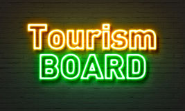 Tourism board neon sign on brick wall background. Tourism board neon sign on brick wall background Royalty Free Stock Images