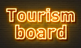 Tourism board neon sign on brick wall background. Tourism board neon sign on brick wall background Royalty Free Stock Image