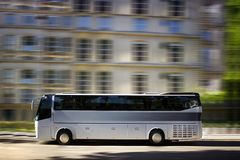 Tourism bus. In the street with speed effect Royalty Free Stock Photo