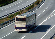 Tourism bus traveling on highway Stock Photo