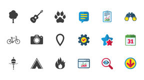 Tourism, camping icons. Fishing, fire and bike. Tourism, camping icons. Fishing, fire and bike signs. Guitar music, photo camera and paw with clutches. Calendar Royalty Free Stock Photo