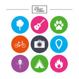 Tourism, camping icons. Fishing, fire and bike. Tourism, camping icons. Fishing, fire and bike signs. Guitar music, photo camera and paw with clutches. Classic Stock Photo