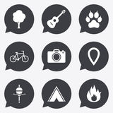 Tourism, camping icons. Fishing, fire and bike. Tourism, camping icons. Fishing, fire and bike signs. Guitar music, photo camera and paw with clutches. Flat Royalty Free Stock Photography