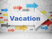 Tourism concept: arrow with Vacation on grunge wall background Royalty Free Stock Photo