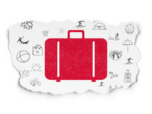 Tourism concept: Bag on Torn Paper background Stock Image