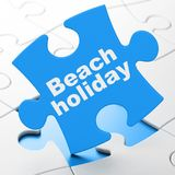 Tourism concept: Beach Holiday on puzzle background Royalty Free Stock Photography