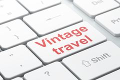 Tourism concept: Vintage Travel on computer keyboard background Royalty Free Stock Photo