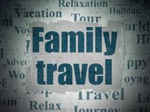 Tourism concept: Family Travel on Digital Data Paper background. Tourism concept: Painted blue text Family Travel on Digital Data Paper background with   Tag Royalty Free Stock Photo