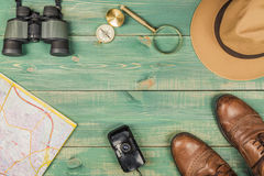 Tourism concept. Magnifying glass, compass, city map, binoculars, brown shoes, fedora hat and old film camera Royalty Free Stock Image